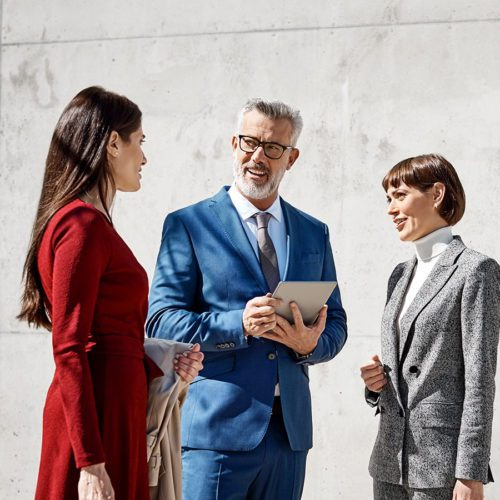 Three colleagues people having a conversation